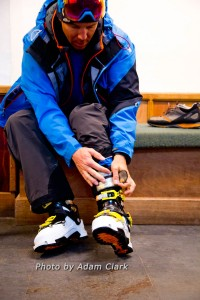 Backcountry skier Chris Davenport buckling in to Scarpa Maestrale boots.