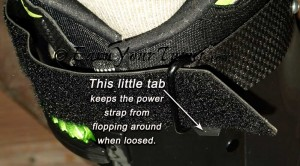 A simple tab of material makes the power strap release faster without causing trouble.