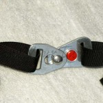 The buckle clasps on easily, requires finger dexterity to unhook.